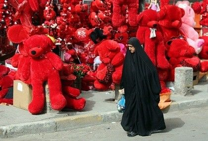 An Iraqi woman walks past a shop displaying red teddy bears in preparation for Valentine's day in Baghdad's Karrada district on February 12, 2014. AHMAD AL-RUBAYE/AFP/Getty Images